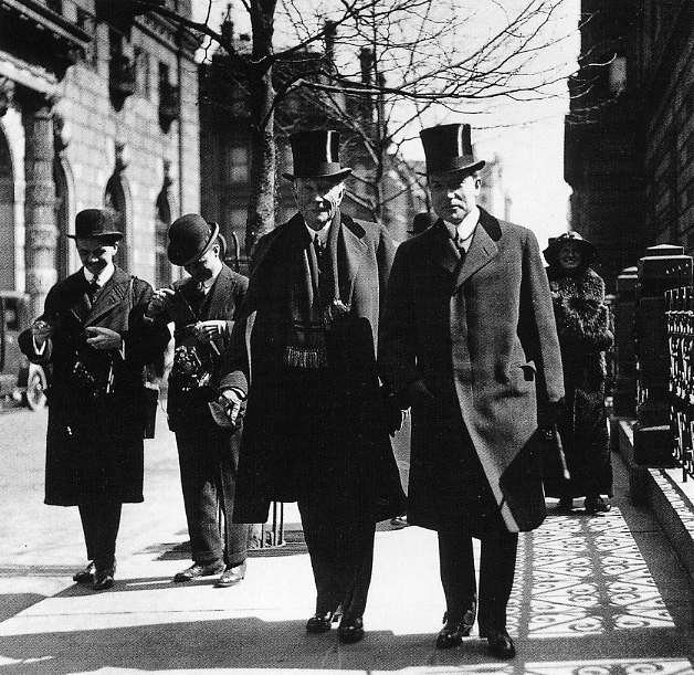 John D. Rockefeller and his son, John Jr.  (he owned the Standard Oil company for 30 years  before the Supreme Court broke it up in 1911 into competing oil companies)