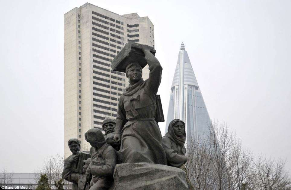 The imposing hotel - dubbed the Hotel of Doom by some outlets for the length of time it has taken to build and open - looms over a war monument in the North Korean capital