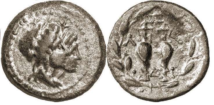 Lakedaemon, Laconia, AE 19, 35-31 BC. Jugate busts of the Dioscouri to right, wearing laureate pilei, stars above their heads / Λ-A across upper fields, Δ-A across lower fields, two amphorae entwined by serpents, all within olive wreath. BMC 37; Grunauer series XV.