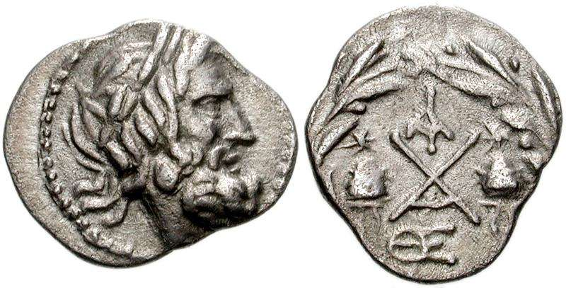 Achaean League, Lacedaemon (Sparta) AR Hemidrachm. ca 175-168 BC. Laureate head of Zeus Amarios right / AX monogram, Caps of Dioskouroi on either side, ΛA monogram above, QE monogram below, all within wreath. SNG Cop 319.