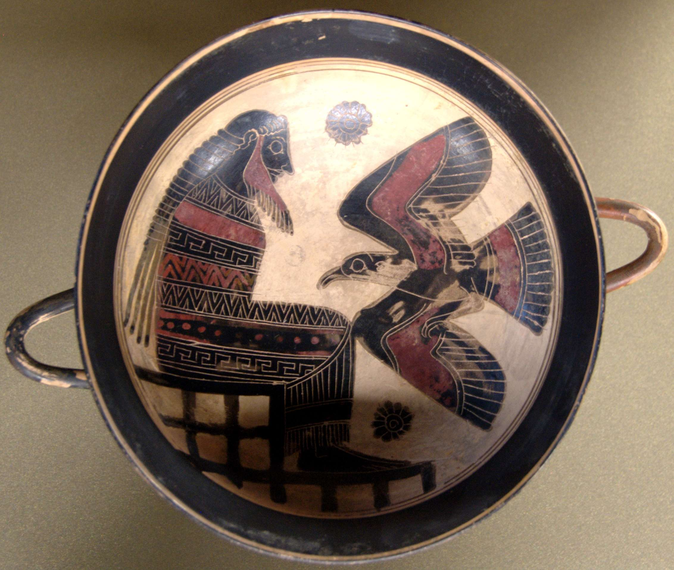 Ο Ζεύς με τον αετό. Zeus with eagle. Tondo from a black-figured Laconian cup, ca. 560 BC.