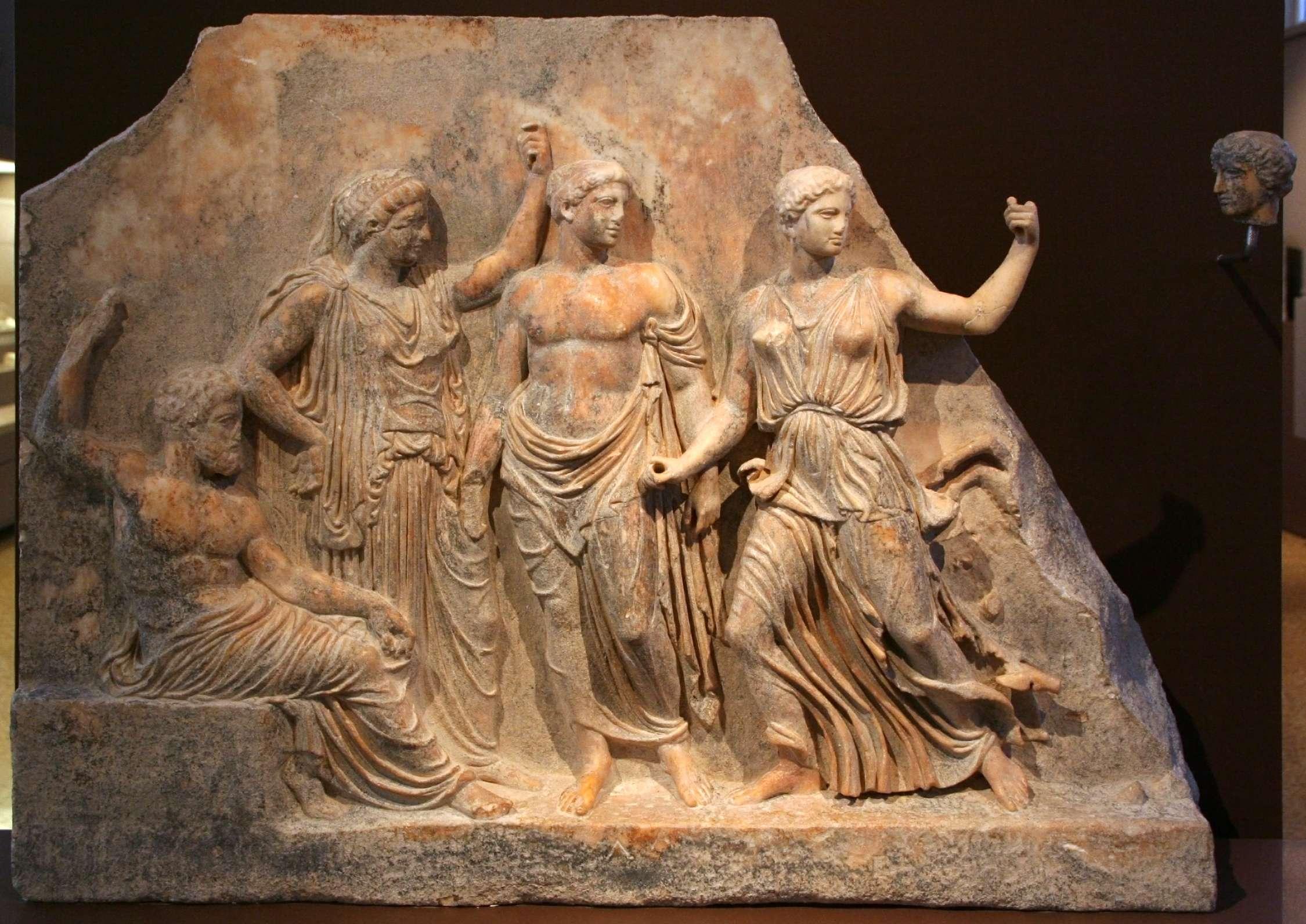 Ανάγλυφο με τον θεό Δία και τη Λητώ. A relief showing Zeus and Leto with their offspring Apollo and Artemis to the right. 420-410 BCE. (Archaeological Museum of Brauron, Greece)