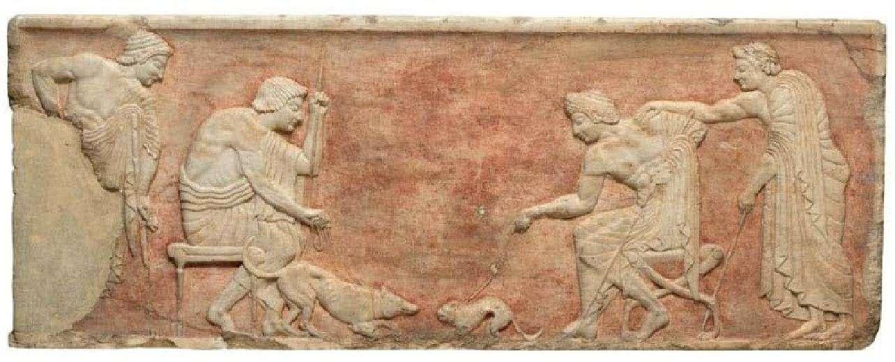 Δύο νέοι βάζουν σε συμπλοκή έναν σκύλο και μια γάτα. Μαρμάρινο ανάγλυφο από βάση αγάλματος που βρέθηκε εντειχισμένη στο Θεμιστόκλειο τείχος της Αθήνας. Γύρω στα 510 π.Χ. Εθνικό Αρχαιολογικό Μουσείο.