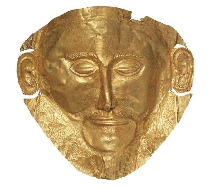 """Χρυσή νεκρική προσωπίδα, γνωστή και ως προσωπίδα του Αγαμέμνονα». 16ος αιώνας π.χ. Μυκήνες. Εθνικό Αρχαιολογικό Μουσείο. Αθήνα. A golden face mask, also known as the mask of Agamemnon. """" 16th century, eg. Mycenae. National Archaeological Museum. Athena."""