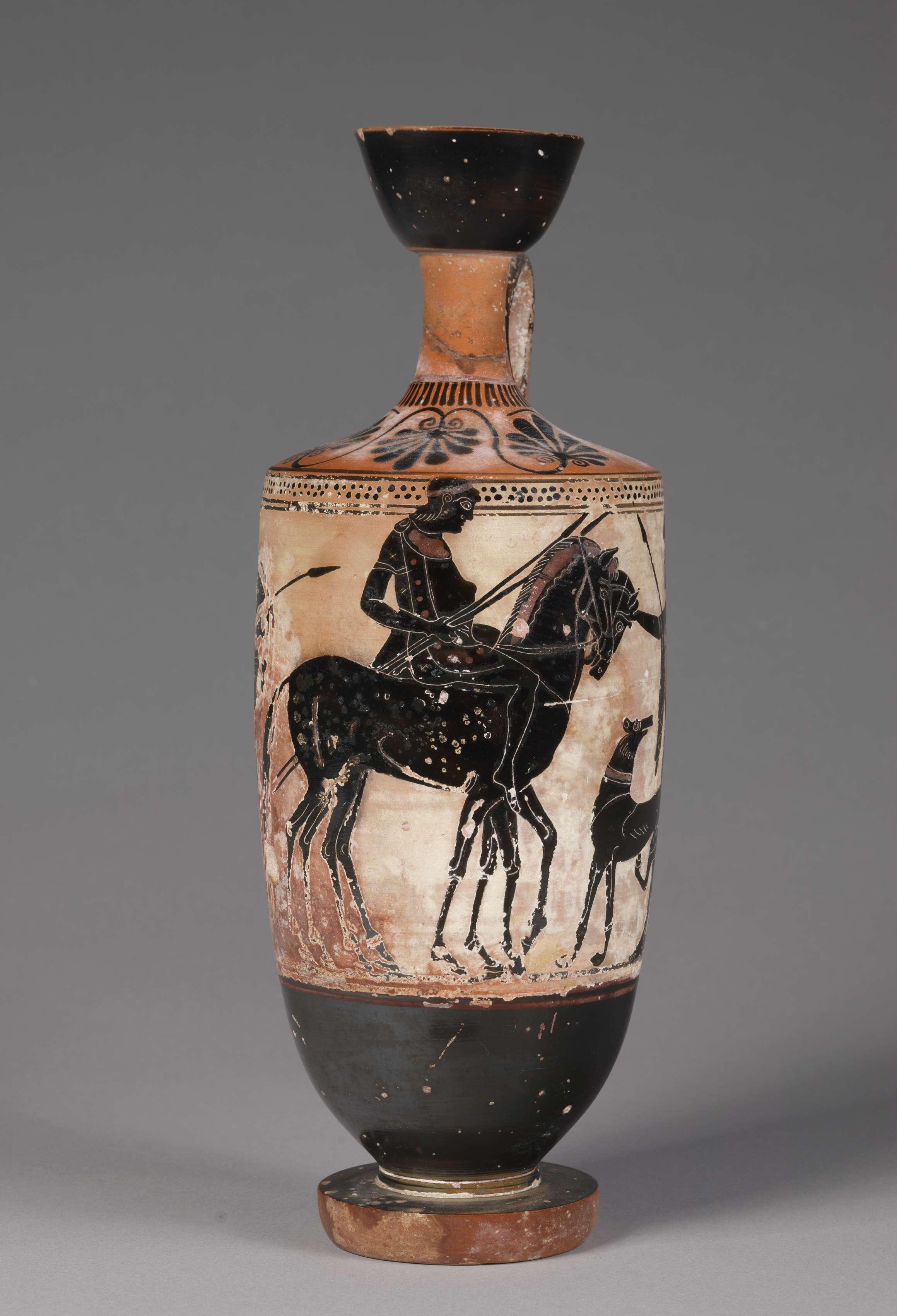 Ιππέας. Black-Figure Lekythos (Oil Vessel): Horseman, Horse between Warriors, Dog. c. 500 BC. Μουσείο Τέχνης του Κλίβελαντ.
